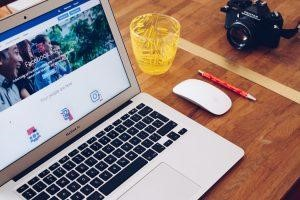 Laptop showing Facebook ads.