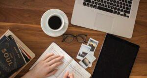 A woman writing down brand awareness marketing tips.